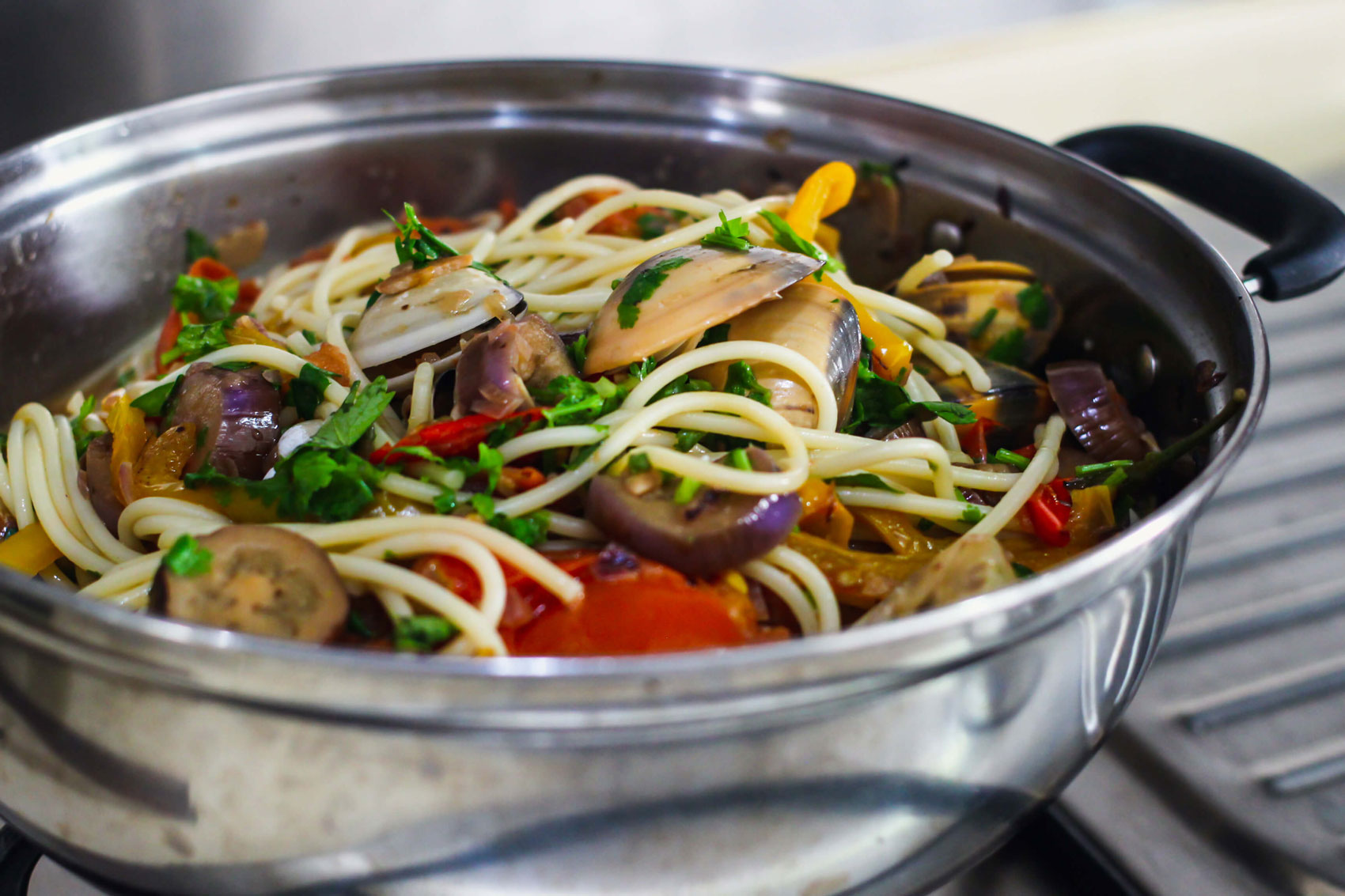 Freshly made Spicy Clam Pasta in a large pot.