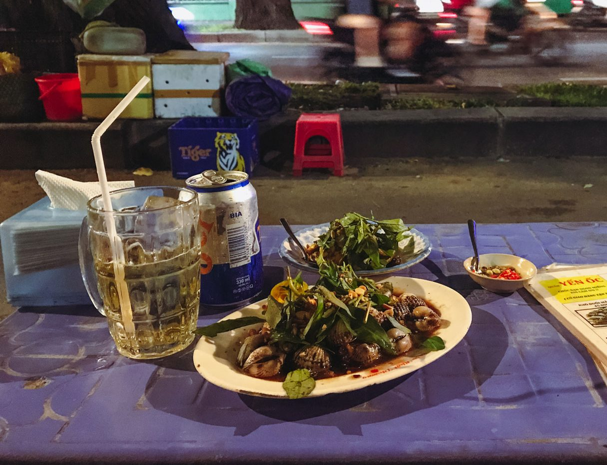 Two delicious dishes served with a glass of beer.