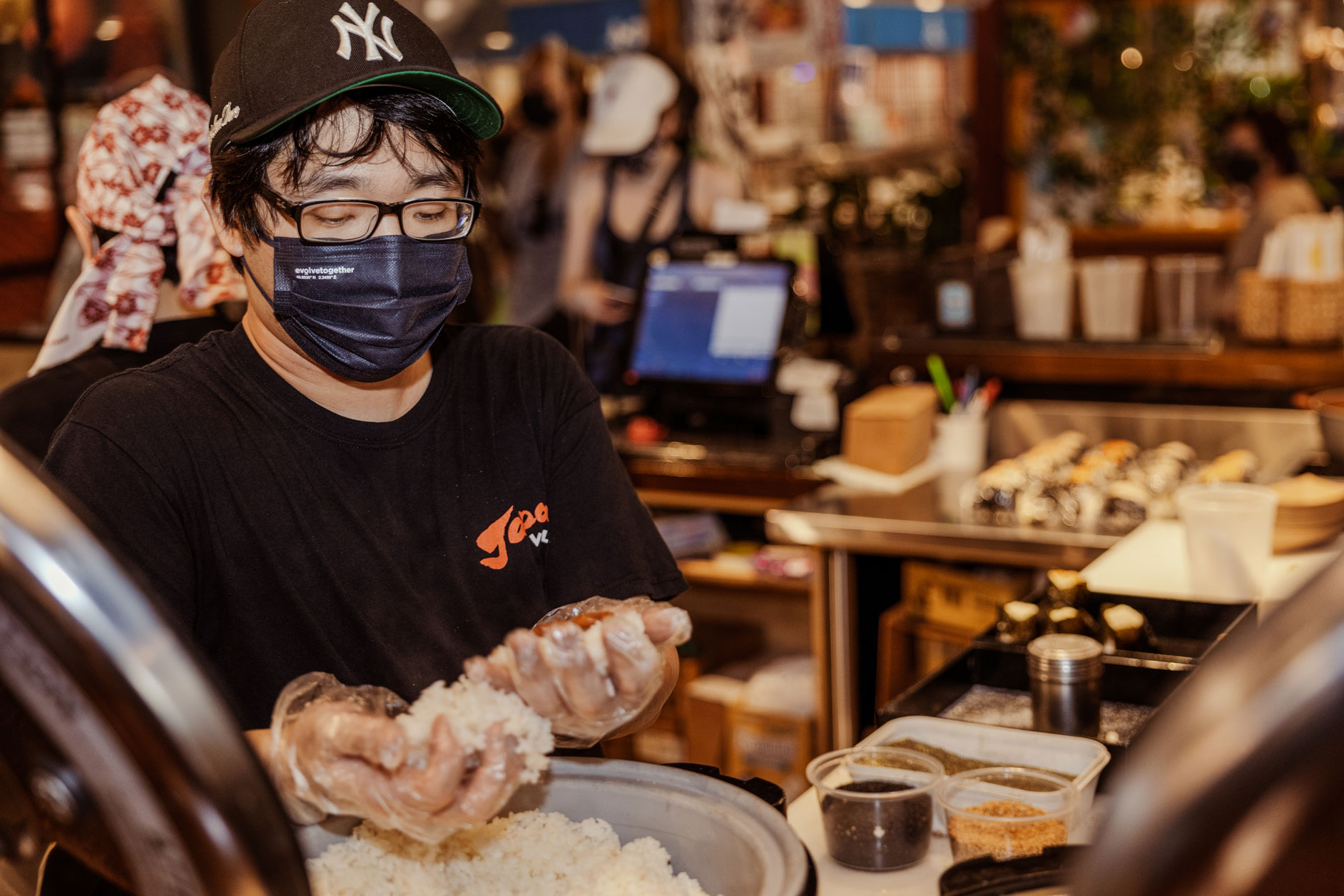 A person making rice balls.