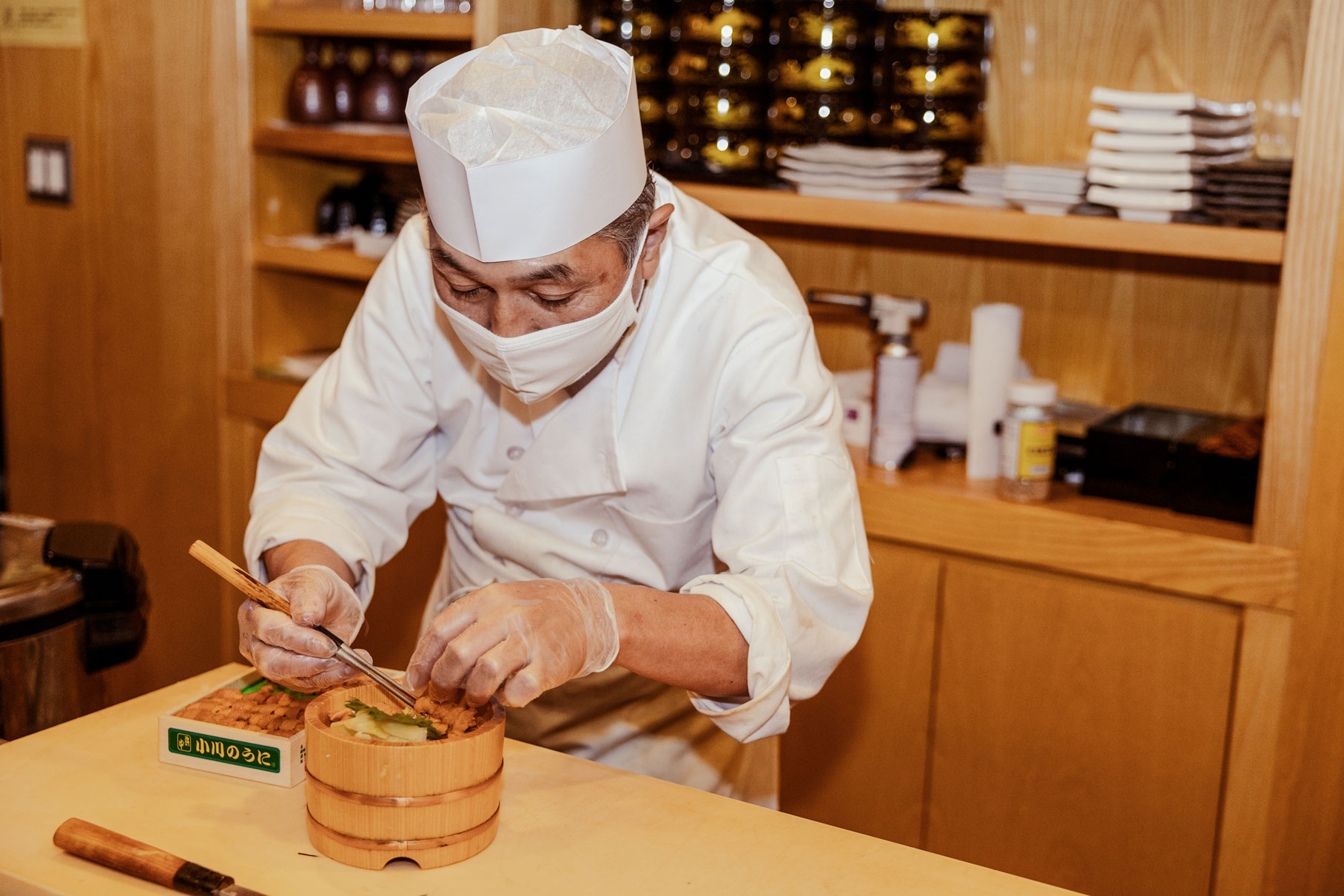A chef delicately plating an ornate dish.