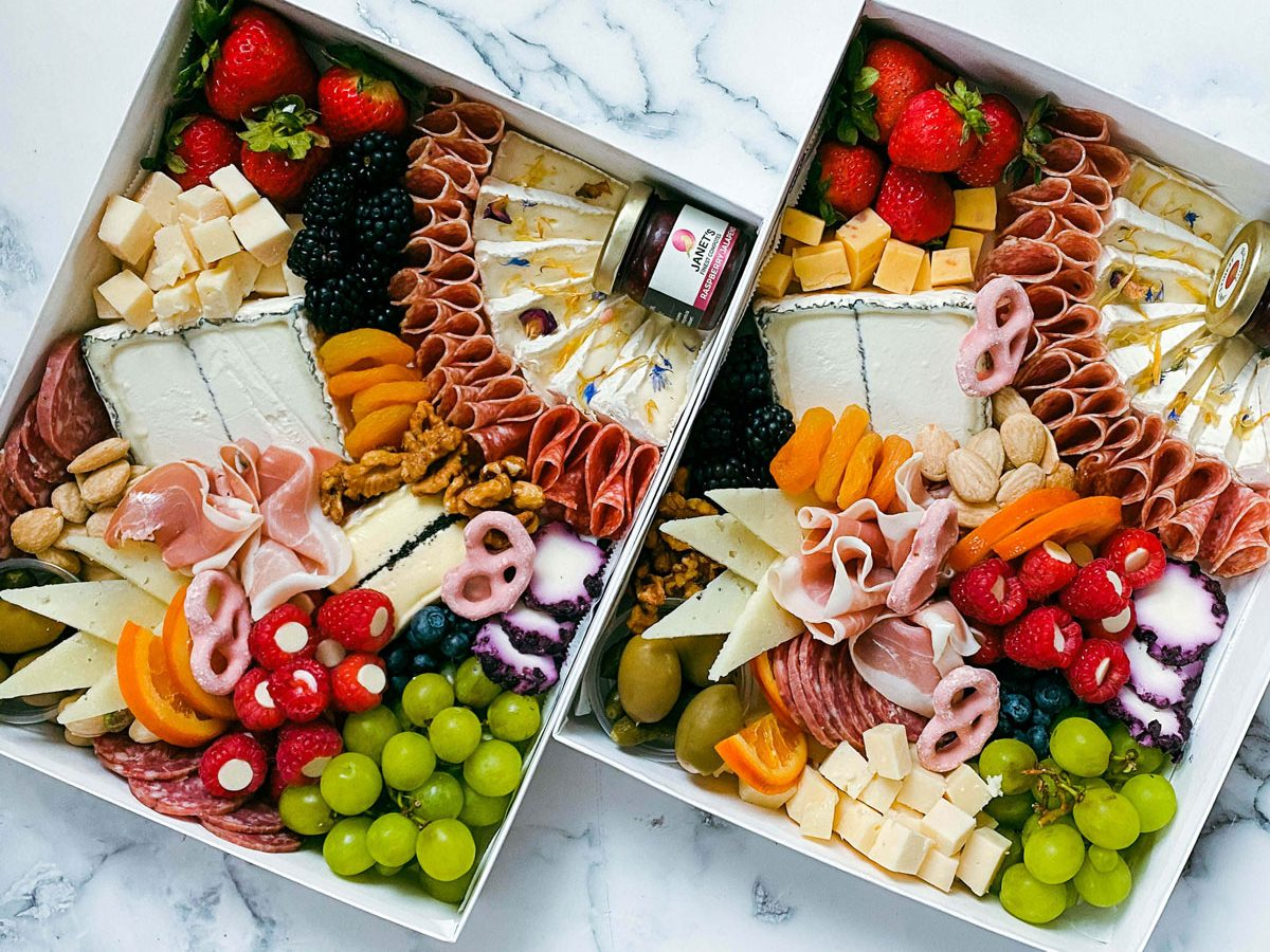 Two large, overflowing picnic boxes.