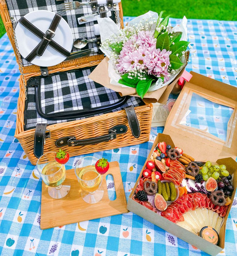A picnic setting featuring food from Bijou Baskets.