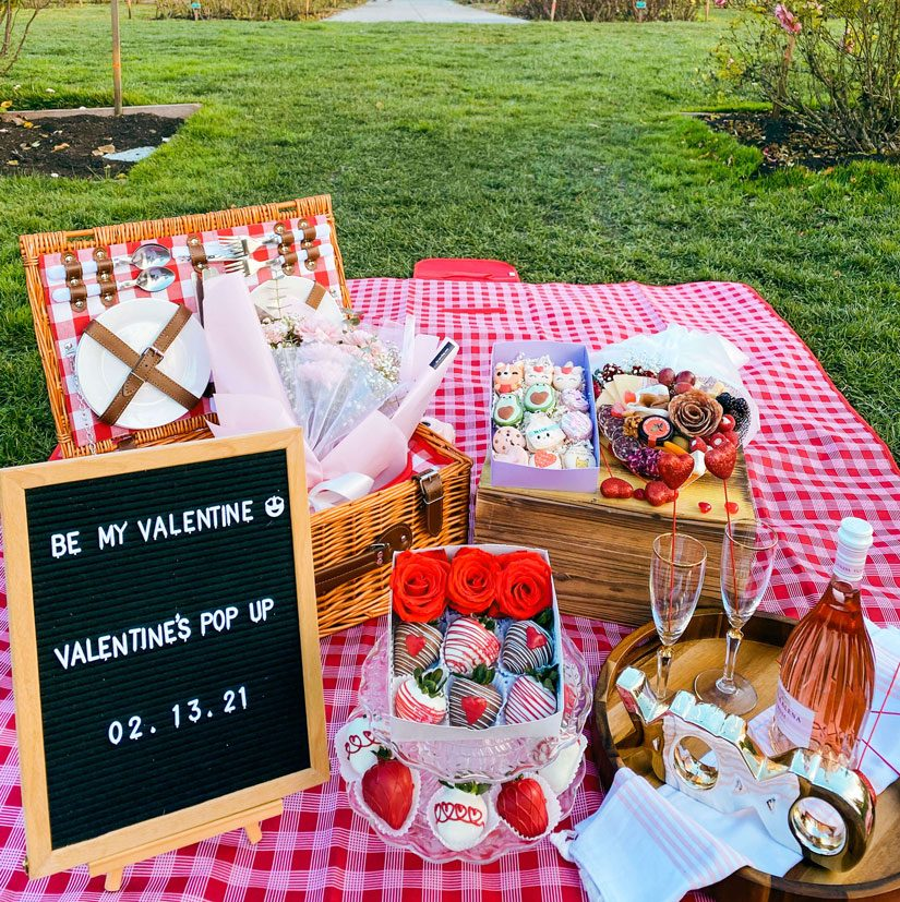 A Valentine's Day picnic set at the park.