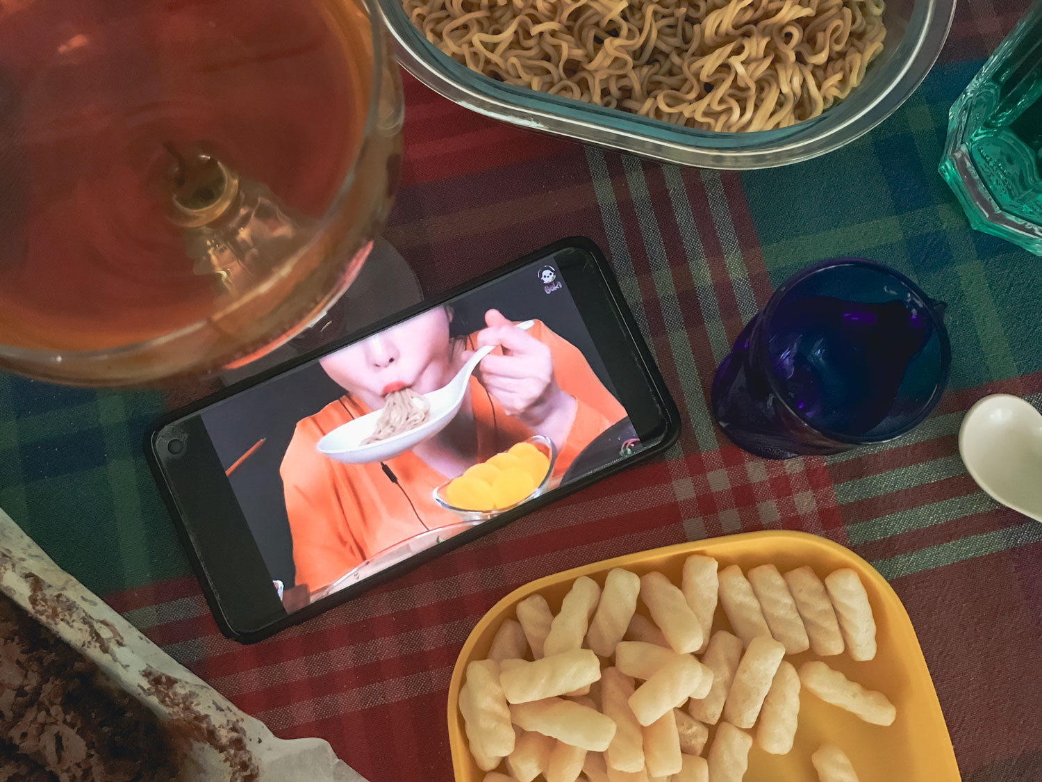 An open smart phone featuring a person eating.