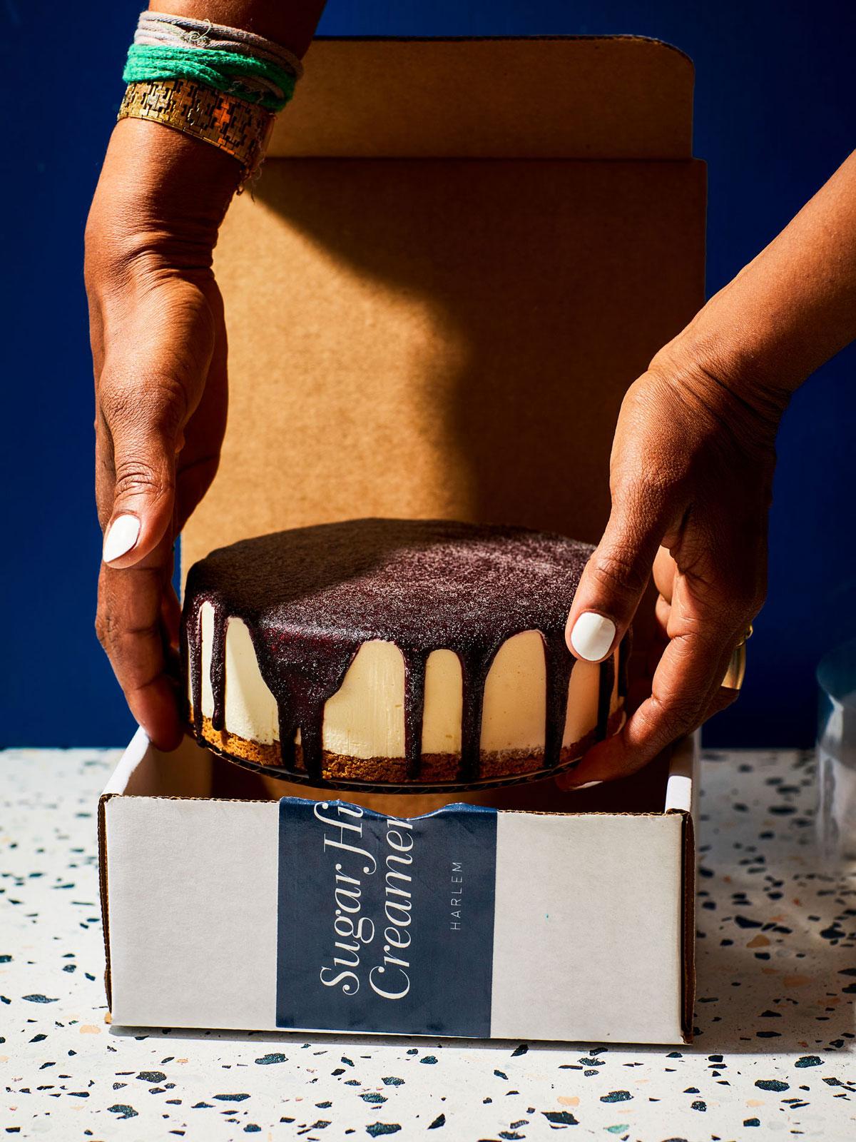 A person placing ice cream cake into a box.